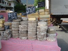 Tommes for sale in Contamines market