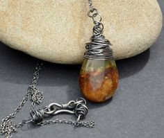 Sterling silver and wire wrapped jade drop necklace. £23.00