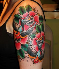 Tattooer Myke Chambers  Love this swallow rose arm piece!