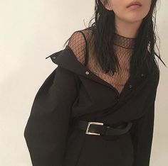 fishnet top under a bodysuit or smth with like thigh high boots and a big coat?