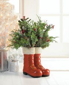 """by Christmas Collection How charming! This decorative vase looks like Good Saint Nicks classic red boots, complete with fur at top and golden buckles below. You'll sprinkle your room with some Christmas magic when you put this vase on display. 8"""" x 10"""" x 10.5""""  allgooddecor.com #allgooddecor #decor #candles #accents #figurines #furniture #gifts #decorations #lighting #mirrors #fountains #outdoor #toys"""