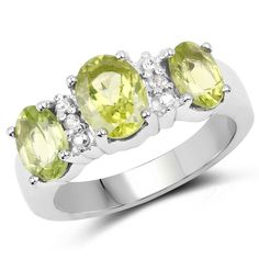 Gorgeously rendered in lustrous sterling silver, this elegant ring is set with beautiful, genuine peridot and topaz stones. A high-polish finish enhances the ring, completing it with a radiant shine.