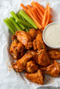 Saucy Buffalo Wings in basket with celery and carrots and a side of ranch dressing Parmesan Chicken Breast Recipe, Crispy Baked Chicken Thighs, Crispy Baked Chicken Wings, Oven Baked Chicken Parmesan, Baked Chicken Tenders, Baked Chicken Breast, Chicken Strip Recipes, Sandwiches, Buffalo Wings