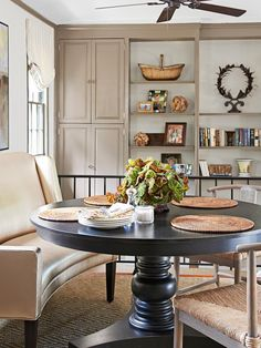 Classic decorating with the twist: neutral dining area with pedestal table with a settee in metallic vinyl for seating #hgtvmagazine http://www.hgtv.com/decorating-basics/classic-decorating-youll-love-forever/pictures/page-5.html?soc=pinterest