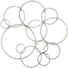"""Silver Circles Wall Decor:Hammered iron rings sculpted in interlocking circles put a signature on a feature wall in your home or office that's clean, direct and effusive—bubbly, even. Clearly modern, it's at home in traditional settings, too. Who can argue with bubbles, after all? 30.25""""W x 0.75""""D x 30""""H"""