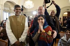 Week of Dec 6-12, 2014 Nobel Peace Prize laureates Malala Yousafzai and Kailash Satyarthi are welcomed by Thorbjørn Jagland, chairman of the Nobel Peace Prize Committee, before their news conference Tuesday in Oslo ahead of the award ceremony. Odd Andersen/Agence France-Presse/Getty Images
