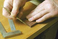 Marking out the inlay recess. Note how the scalpel is held at an angle to precisely undercut the inlay