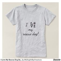 """I Love My Rescue Dog Basic T-ShirtThis women's basic t-shirt shows your love for animals and animal rescue. It states """"I love my rescue dog!"""" The word """"love"""" is spelled with the letter O represented by a paw print with a red heart inside surrounded by the words adopt, foster and rescue separated with purple paw prints. This is a great gift for yourself or any animal lover. This could also be used by animal shelters as a raffle item, in a silent auction fundraiser or 5K run prize."""