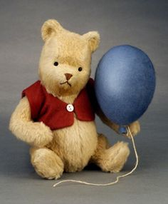 "RJW Dolls presents - Pooh.  9""; mohair plush; fully jointed; glass eyes/embroidered features; felt jacket, holding all-felt balloon. Date of Release: 2003 Edition Notes: Ltd. ed. 500. Made exclusively for Japan. Please contact BEANS, INC."