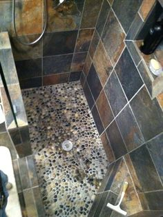 We have to replace the tile floor in our double shower. Looking for new ideas.