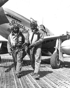 2 Tuskegee Airmen in front of their P-51 Mustang