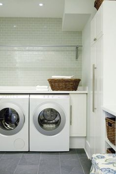 Spacious Laundry Room A front-loading washer and dryer offer maximum counter space. Laundry Mud Room, Home, Slate Flooring, Closet Bedroom, Show Home, Living Room Designs, Spacious, White Laundry Rooms, Room
