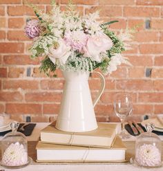 Like the jug centrepiece but am more focused on the cupcake cloches with flowers inside
