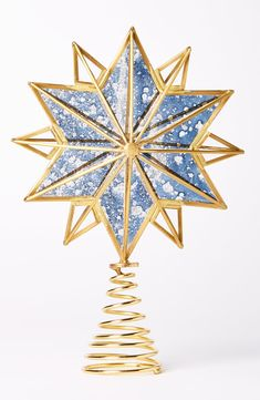 Add a touch of wintry glow to your decorations with this bright brass and glass tree topper.