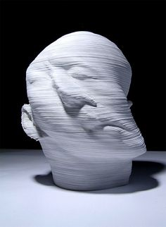 Impressive Head Sculptures by Beijing-based artist Li Hongjun.  The artist cuts into layers and layers of paper to create these surreal sculptures.