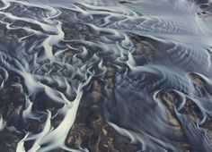 This image is aerial photo of glacial river in Iceland. The river divided into a great number of interlinked streams and flows writes photographer Andre Ermolaev. [2000 x 1446] #reddit