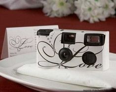 Disposable Wedding Camera for the guest to also take pictures so you will have pictures from all angles and ones that the photographer might miss!!!! absolutely love this idea.