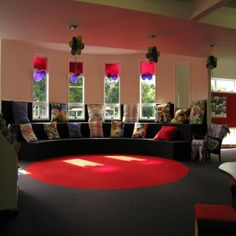 Red Reading Area, featuring raised curved bench seating with cushions | Services to Schools