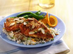 Chicken dinner in 30 minutes? Try crispy chicken with a kick of ginger complete with tasty orange rice.