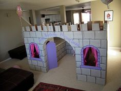 Cardboard Castle Inspiration. Love the custom curtains and purple touches!