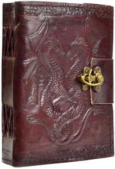 "Hand tooled blank leather journal with twin dragons twined together. Border embossing may vary. Sizes vary slightly. Leather, handmade paper. 240 pages, latch closure. 5"" x 7"""