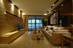 Long narrow living room with built-in TV bench, long sofa on light wood floor