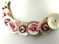$45 Fabric and Agoya Shell Button necklace!  Soft honeysuckle pinks and reds highlight the mother of pearl buttons.