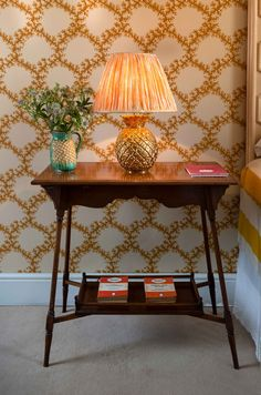 Soane Britain's Pineapple Table Lamp with a Ripple Stripe fabric Lampshade, backed by Seaweed Lace wallpaper in Indian Yellow.