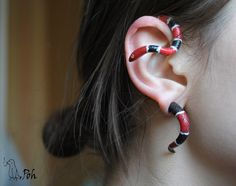 I love this, but instead of clay, cut a plastic toy snake and glue it to a flat base post earring