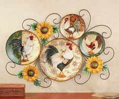 This scrolling metal framework holds four country style rooster plates (included). The French country rooster design is the perfect compliment to your kitchen.