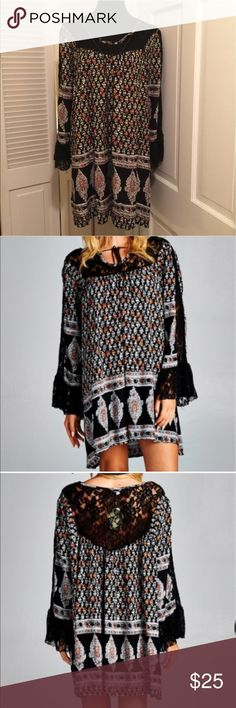 ✌🏼Beautiful Boho Black Lace Dress/Tunic✌🏼 ✌🏼Beautiful Boho Black Lace Dress/Tunic✌🏼These are a similar style of a popular brand and at a fraction of the price! The pattern is black, white, & gray with orange accents. Black lace on the front, back, and sleeves make this extra special. The front ties and has tassels. Oversized. NWT and is in the original packaging. Small, medium, and large sizes available😉 Dresses Mini