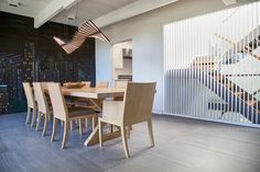 Dining Room - operable louvers at stair, original Jose Moya del Pino cityscape mural, Vibia Rythm light, Hermés table and chairs