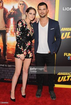 Actress Kristen Stewart and actor Taylor Lautner arrive at the Los Angeles Premiere 'American Ultra' at Ace Theater Downtown LA on August 18, 2015 in Los Angeles, California.