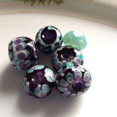 Dark purple and teal handcrafted glass beads by Blueberry Bay Beads