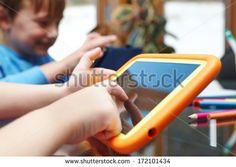 http://www.shutterstock.com/pic-172101434/stock-photo-children-playing-on-digital-tablet-at-home.html?src=FHlC6Ti-yAtPmROzRyiSdA-3-15