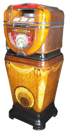 """Wurlitzer Model #81 Juke Box w/original stand  #810 """"Mae West"""" Stand. Rarest and most desirable of all counter models. Straight through 1941 the Wurlitzer Victory Model # 81 continued it's sensational success in enabling Wurlitzer Music Merchants to dominate the small location field."""