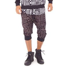 Unisex 3/4 drop crotch sweatpant jogger with bold all-over print inspired by African mudcloth textile.  Available in Black/Chocolate, Black/White, and Sky/Purple.  Designed by AndreasOne for PEACEfits.