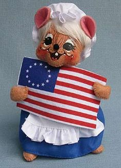 """Annalee 6"""" Betsy Ross Mouse with Flag  Annalee Doll Description: Open eyes, open mouth, white hair, brown body, white bonnet, blue dress, white apron, holds colonial American flag. Companion is 250413. www.suecoffee.com"""