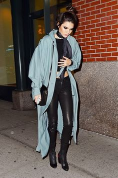 Kendall Jenner tosses a duster jacket over leather skinny pants and a crop top for a night out