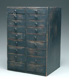18-drawer storage case, pine with old green paint. 19th century. Sold March 2006 650.00  20.25 in high x 18 in wide x 12.25 in deep