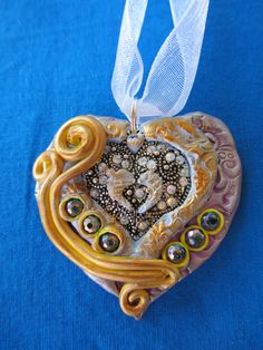 polymer clay heart pendant by Artist Patty Lewis