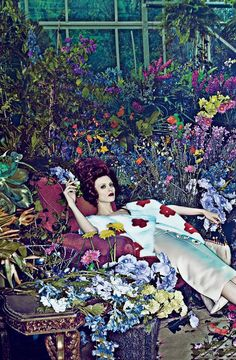 Models Karen Elson and Carolyn Murphy find a flowery world to match their Prada dresses. Photographed by Steven Klein, Vogue, 2013.