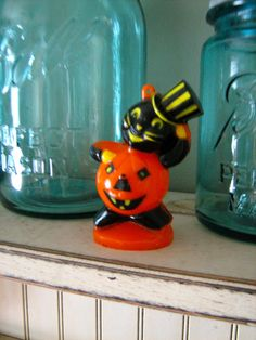 Vintage Halloween Rosbro Plastic Pumpkin Body Cat Man with Top Hat Collectible Candy Container 1950s.  via Etsy.