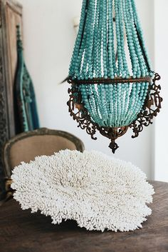 "Turquoise Beaded Chandelier. BBC Boracay says: "" Light and bright chandelier in romantic turquoise. We have one similar in shape but made with small Puka shells from Boracay Island, Philippines."""