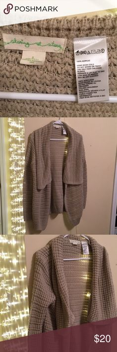 Color Cream/sand knit cardigan Worn maybe 5x if I can even remember. Cute, lightweight cardi from urban outfitters. Has slight discoloration (bluish) from jean color leaking onto it (located at very bottom of cardigan)! You really can't see it it though! Tried capturing it with and with-out flash. Ask for more pics if necessary and I'll try to do my best! Staring at Stars Sweaters Cardigans