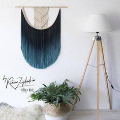 The EVA large macrame tapestry features a modern geometric design. In a unique and specialized process, Rianne adds a gorgeous gradient dye to the fringes of the tapestry. This design comes in a S, M, L and XL size. - Designed and handmade by Rianne Zuijderduin in The Netherlands,