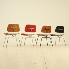 Set of four Evans editions of the Eames DCM chair | From a unique collection of antique and modern dining room chairs at https://www.1stdibs.com/furniture/seating/dining-room-chairs/