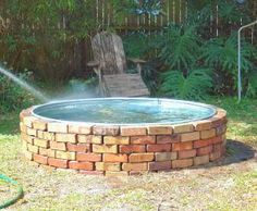 "Horse trough pool - had one when I was a kid but it wasn't ""blinged"" out with bricks"