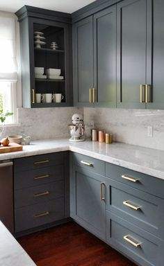 Remodeling Kitchen Cabinets dark gray cabinets and brass hardware Uplifting Kitchen Remodeling Choosing Your New Kitchen Cabinets Ideas. Delightful Kitchen Remodeling Choosing Your New Kitchen Cabinets Ideas. Large Kitchen Cabinets, Kitchen Cabinet Colors, Kitchen Redo, Home Decor Kitchen, Interior Design Kitchen, Island Kitchen, Kitchen Walls, Grey Painted Kitchen Cabinets, Kitchen Storage