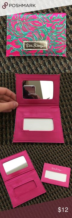 Lilly Pulitzer compact mirror accessory NWOT. Vintage Lilly pattern and accessory! When you open it the top is a mirror and the bottom comes with face oil blotting sheets! Or you can take out the sheets and use it as a wallet or ID case :) great condition! Lilly Pulitzer Accessories